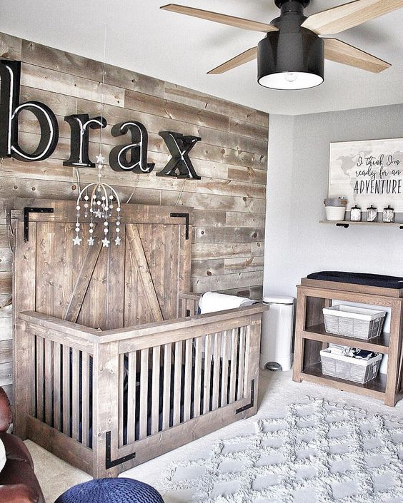 organic wooden baby crib wood plank walls white textured area rug wooden washing table for baby oversized ceiling fan with center light fixture