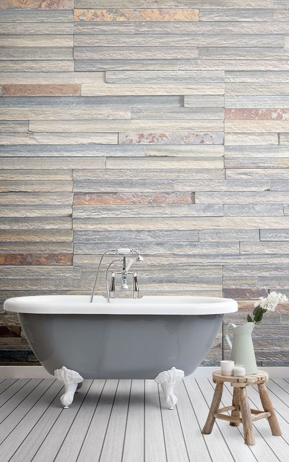 rough texture mural in soft tone clawfoot bathtub small wooden stool white wood plank floors