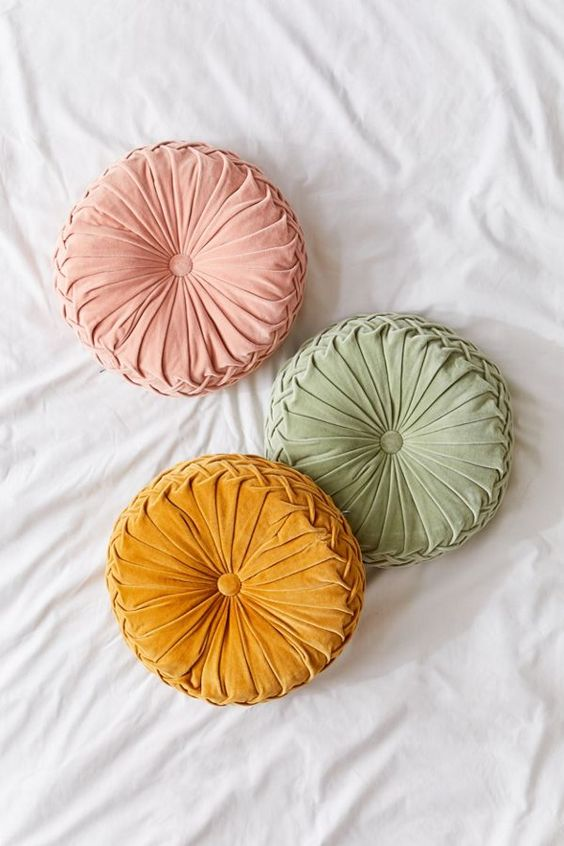 round pintuck accent pillows in colorful velvet finishes