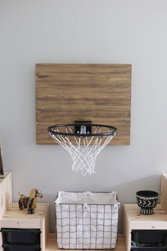 sport feature in boy's room wire basket with textile cover light wood shelving units