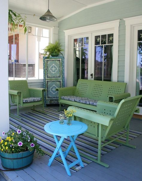 summer veranda idea colorful stripes area rug outdoor furniture set in green round top side table in blue corner storage solution