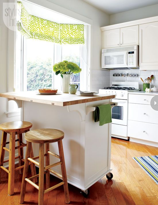 tiny kitchen island with wood top wooden modern stools white kitchen counter top white cabinetry wood floors