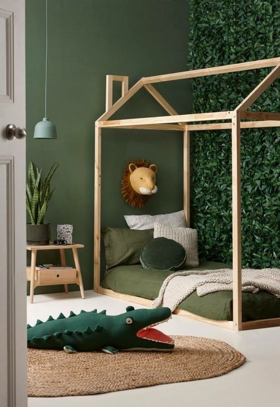 vines wall panel idea wooden house like bed frame green bedding treatment wood bedside table green painted walls green aligator flat woven area rug in round shape
