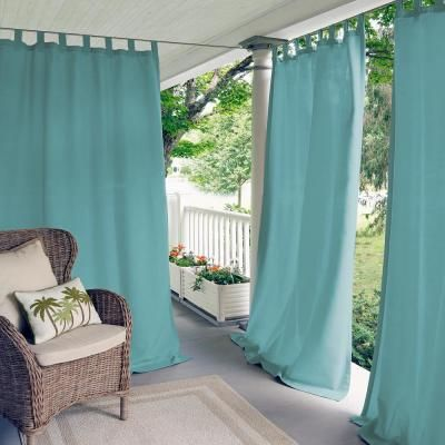 water resistant outdoor curtains in blue rattan corner chair with cushion and throw pillow white rug