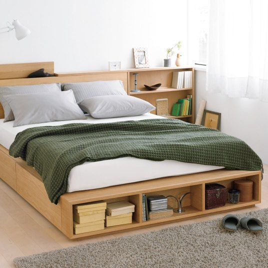 wooden bed frame with headboard integrated with shelves and under storage