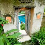 Bali Style Outdoor Space With Gate And Tropical Plants