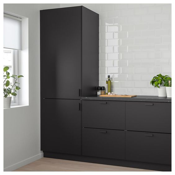 Ikea's black stained kitchen cabinets glossy white subway tile walls small greenery light wood floors