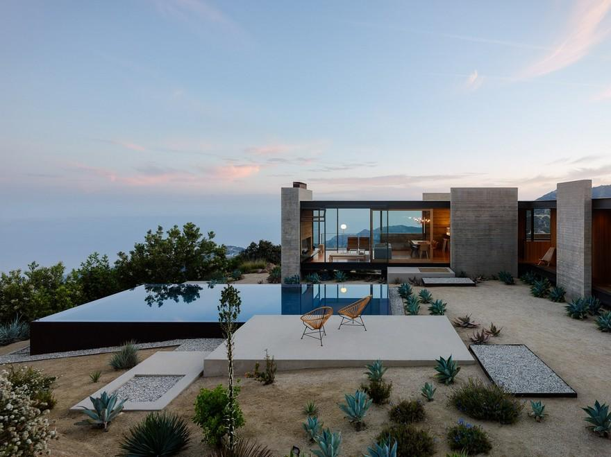 Saddle Peak House's exterior with outdoor pool concrete base sitting area and rocky front yard