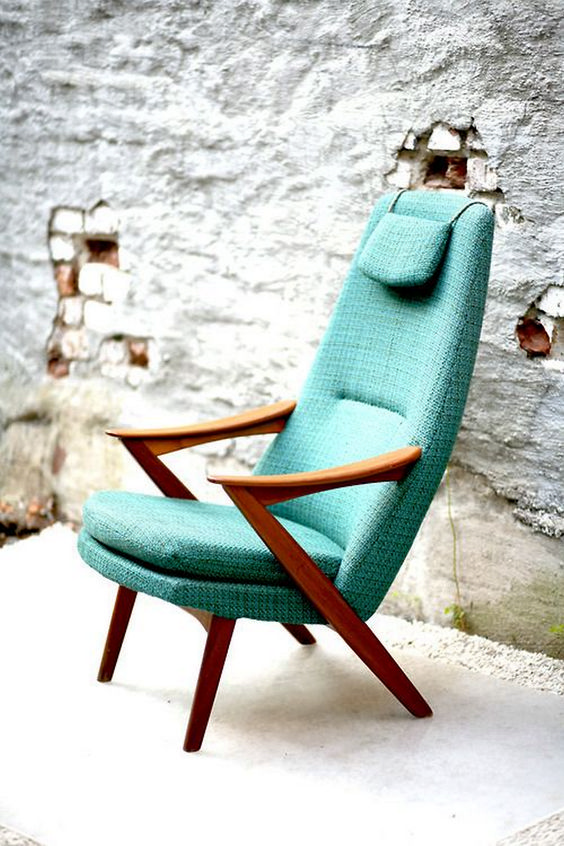 accent armchair with higher back rest and organic wood frame and arm rests