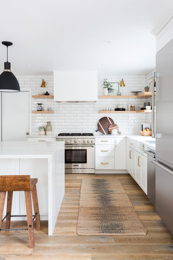 all white kitchen idea white subway tile backsplash open shelving units made from organic wood black pendant earthy brown runner wood floors white cabinets white kitchen island wooden stools