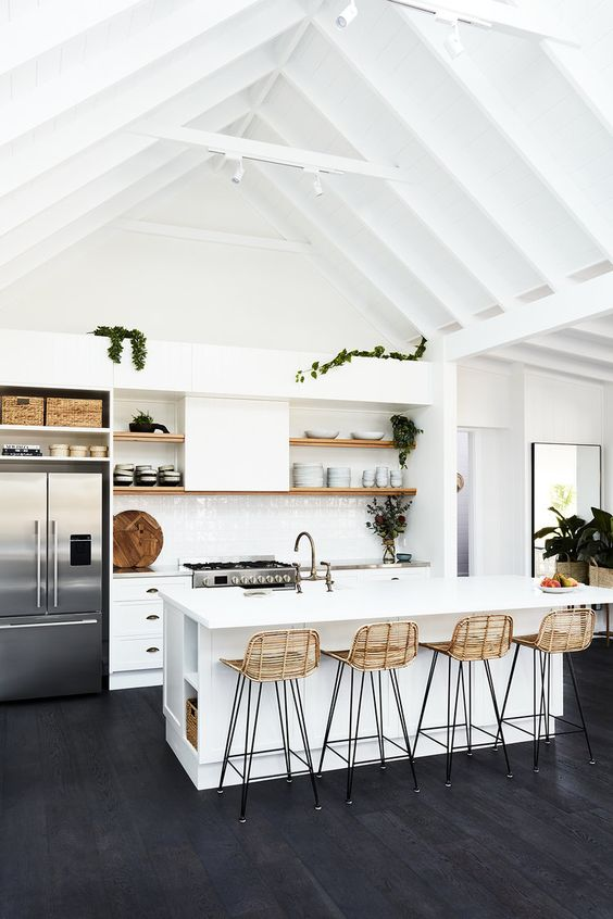 all white kitchen idea with high slanted ceilings white kitchen island stools with woven back white cabinets wooden open shelving units