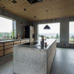 Bare Concrete Kitchen Island With Sink Concrete Walls Concrete Floors Kitchen Counter With Wood Panels And Concrete Countertop