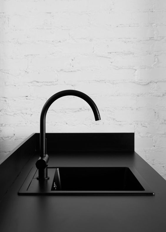black kitchen countertop with black sink and faucet black countertop