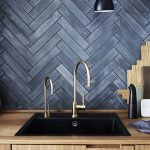 Blackwashed Wood Backsplash In Herringbone Motifs Brass Finish Faucets Modern Black Sink Wooden Kitchen Counter And Top