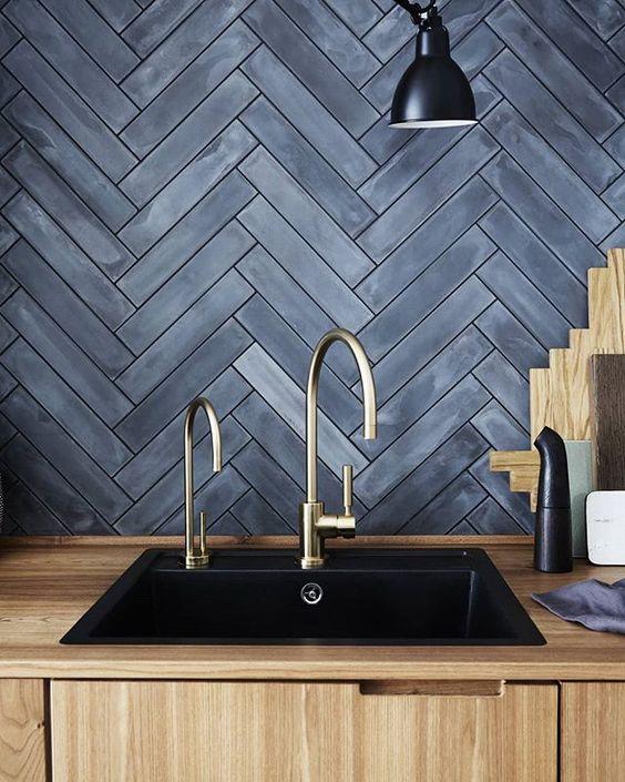 blackwashed wood backsplash in herringbone motifs brass finish faucets modern black sink wooden kitchen counter and top