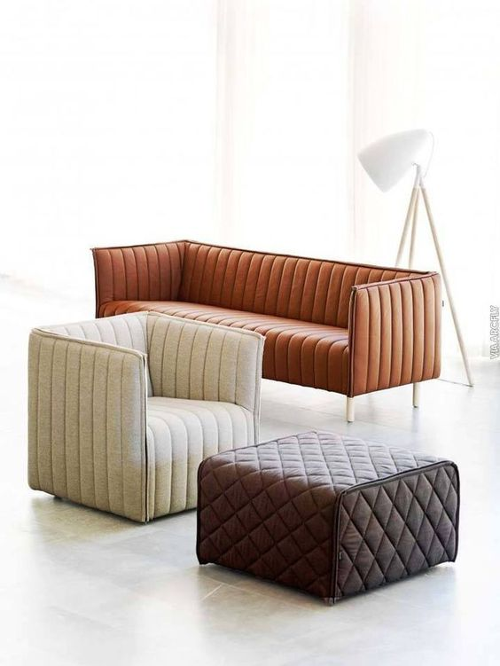contemporary living room furniture pieces in neutral shades and with tufted line accents