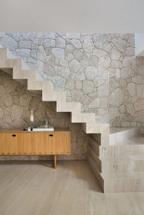 contemporary wall texture in stone finish contemporary concrete stairs with clear glass railing system contemporary wooden console table