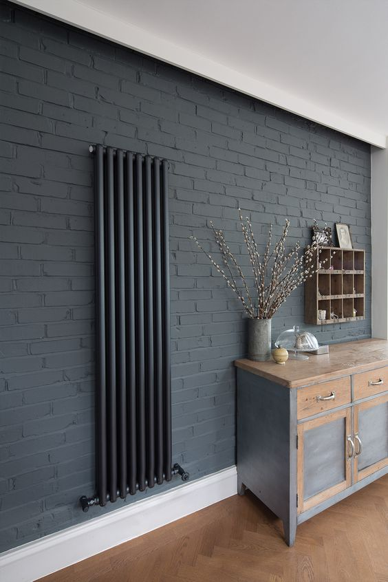 dark gray brick walls black radiator installation wooden shelving unit wood gray cabinet