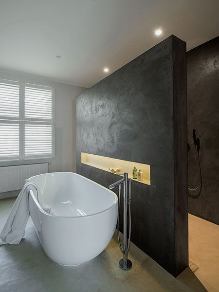 dreamy bathroom idea modern white tub free standing stainless steel faucet recessed shelf inserted in black accent wall