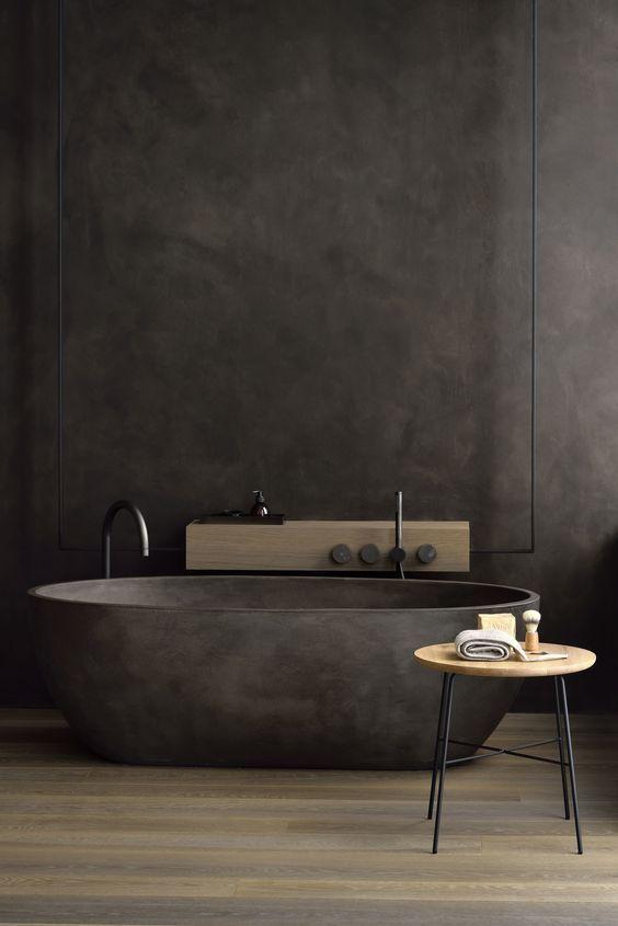 elegant black bathroom matte black bathtub free standing faucet in black stool with round wood top and black metal legs dark wood floors