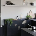 Elegant Black Kitchen Counter In Modern Minimalist With Black Sink Black Countertop Electric Stove White Single Shelf Crisp White Walls
