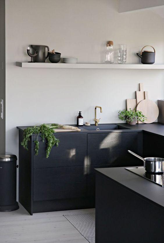 elegant black kitchen counter in modern minimalist with black sink black countertop electric stove white single shelf crisp white walls