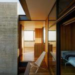 Fancy Yet Minimalist Corridor With Wood Plank Floors Framed With Black Steel Glass Walls
