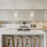 Flat Surface Cabinets On Top White Kitchen Counter With Marble Backsplash Marble Kitchen Island With Sink And Faucet Simple Bar Stools With Gray Round Cushion And Light Wood Legs