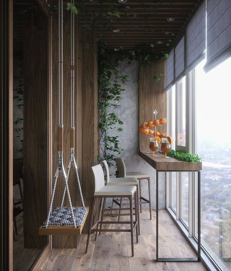 glass covered small balcony with mini bar