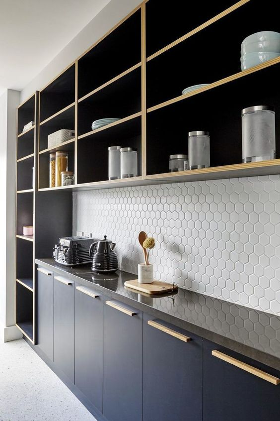hexagon tile backsplash in white glossy black countertop black kitchen cabinets open shelving units