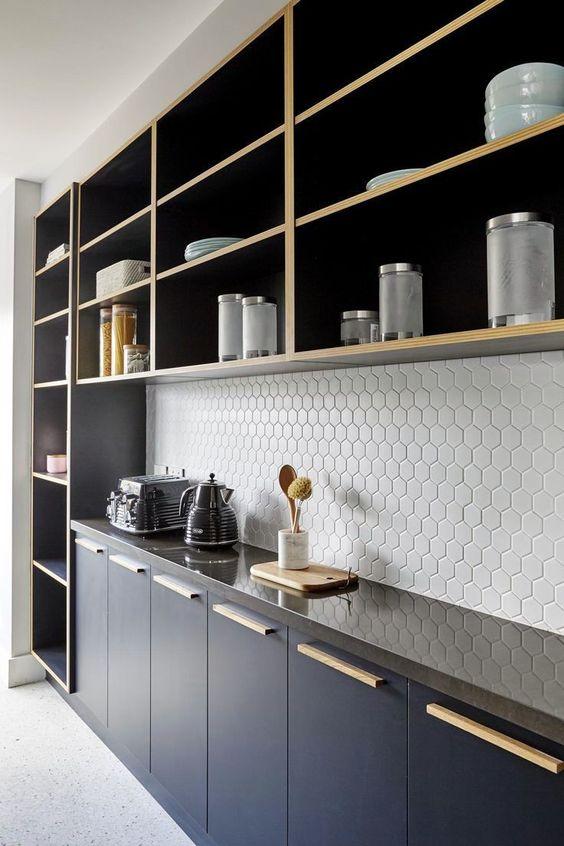 hexagon tile backsplash in white glossy black countertop black kitchen cabinets open shelving units
