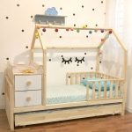 House Bed Idea With Colorful Pompoms Wood Railings Cabinet And Bed Addition
