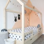 House Bed Made Of Light Wood Material Soft Tone Wall Decoration White Bed Linen With Black Heart Shape Motifs