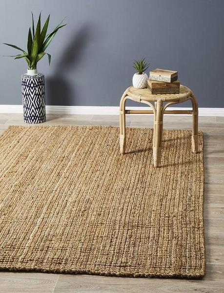 jute area rug made of natural fibre rattan stool ethnic planter