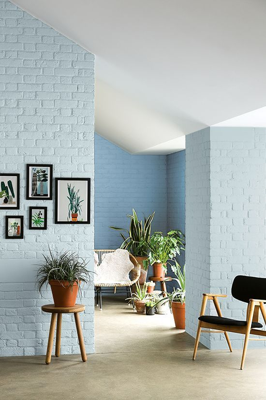 light blue brick walls midcentury modern furniture