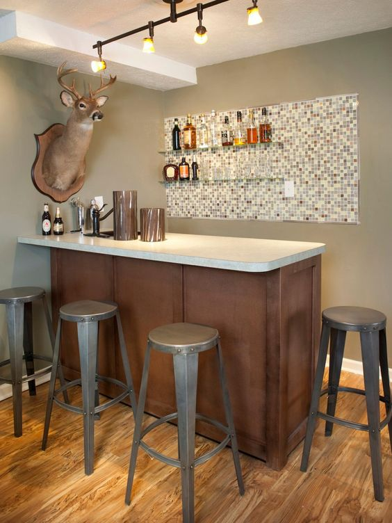 mini cool home bar brown counter with white countertop gray stools mosaic tiled display board on walls for drink bottles