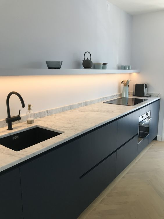 modern kitchen idea with black kitchen marble countertop black sink black faucet electric stove open shelf in white with hidden lamp