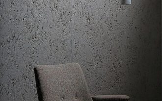 raw concrete wall in natural gray modern accent pendant in light gray modern chair in gray