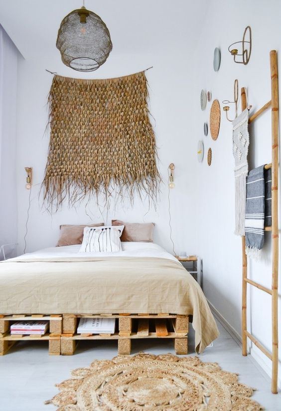 rustic Boho bedroom Boho wall decor soft neutral bedding treatment platform bed with under storage ornate bamboo ladder rack Boho bed mat in round shape accent pendant in black