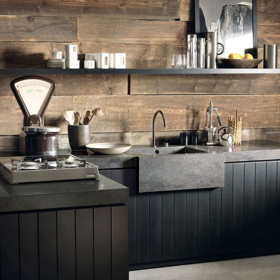 rustic kitchen idea with black kitchen cabinets and countertop black sink stainless steel faucet and hardware wooden wall black open shelf