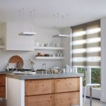 Small Kitchen In All White Kitchen Island With Concrete Top And Organic Wood Paneling Open Shelving Units In White Ultramodern Stainless Stool Glass Window With White Treatment