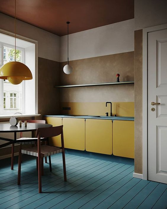 standout modern kitchen idea blue countertop and backsplash blue wood plank floors earthy brown walls yellow cabinets without hardware stunning yellow pendant pendant with white bulb