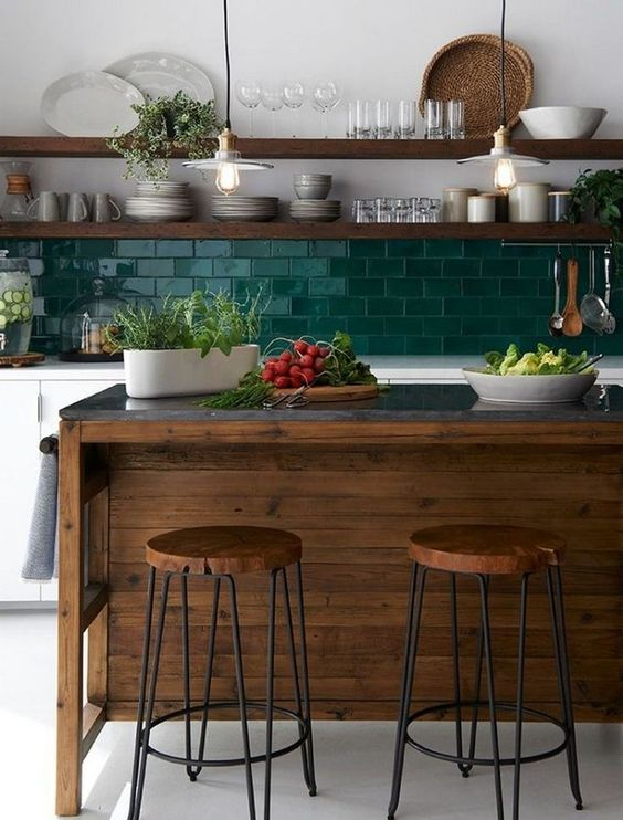 stylish kitchen design bold green tile backsplash open wooden shelving units black top kitchen island with round top stools