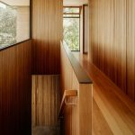 Super Minimalist Hallway And Corridor Of Stairs Dominated By Wood And Glass Windows