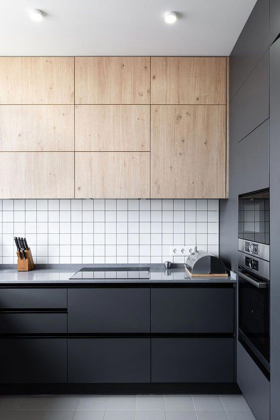 super modern and minimalist kitchen cabinets in matte black flat surface wood cabinets electric stove white tile backsplash