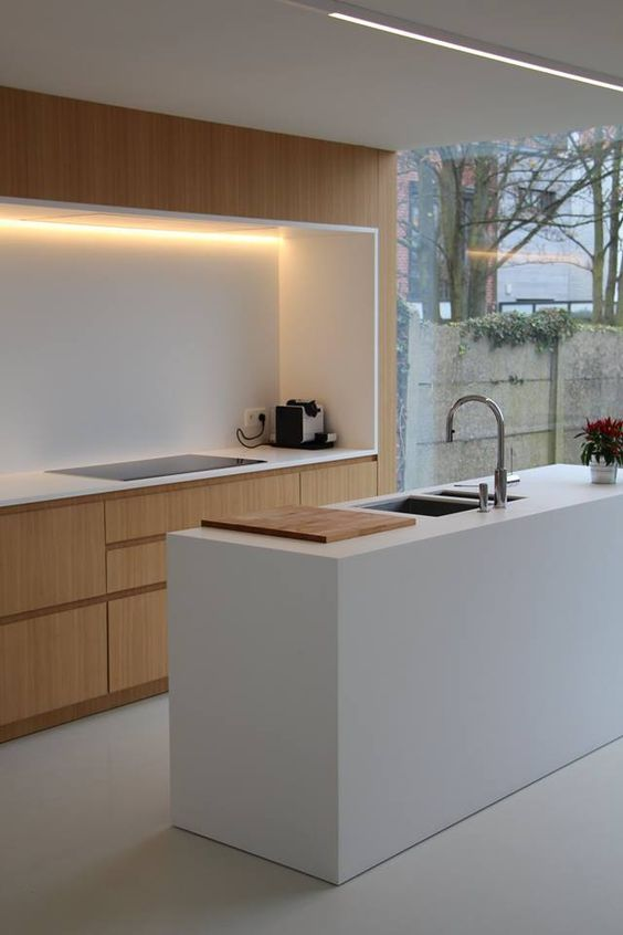 super uncluttered kitchen idea crisp white kitchen island with sink and faucet flat surface wood cabinets electric stove accent light fixture