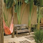 Tropical Outdoor Space Idea Linen Hammock In Pastel Some Huge Tropical Plants Shabby Wood Bench Seat With Back