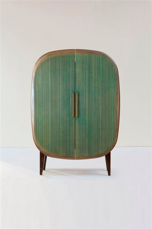 unique cabinet with curved edges and pointed wood legs