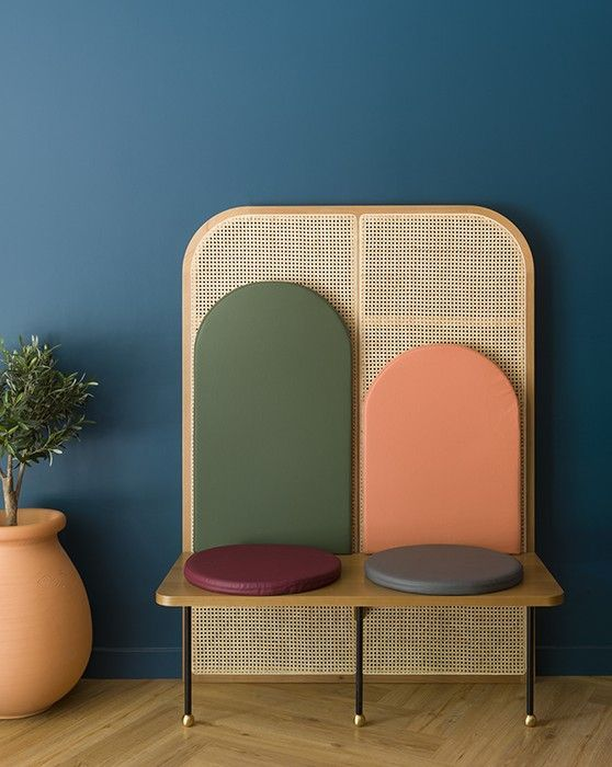 unique seat with woven like backdrop and colorful back rest