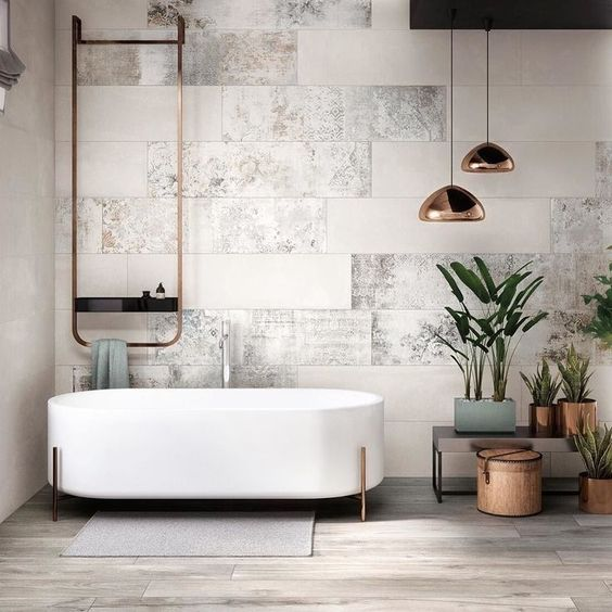 white gray tile wall texture brass finish piping modern white bathtub accent pendants with brass lampshades light wood floors